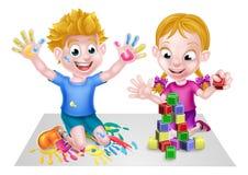 使用与块和油漆的动画片男孩和女孩 免版税图库摄影