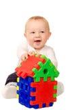 使用与大厦难题的男婴 免版税库存图片