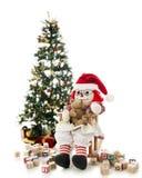 使用与她的圣诞节玩具的Rad玩偶 免版税库存图片