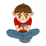 使用与手机动画片的男孩 免版税图库摄影