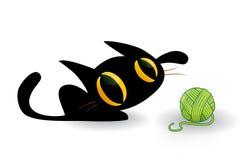 使用与毛线球的逗人喜爱的小猫  免版税库存图片