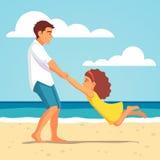 使用与海滩的女儿的父亲 库存照片