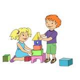 使用与玩具块的小女孩和男孩 免版税图库摄影