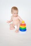 使用与玩具的婴孩 免版税库存图片
