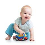 使用与玩具的微笑的孩子 库存图片