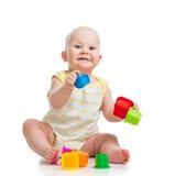 使用与玩具的微笑的婴孩 库存图片