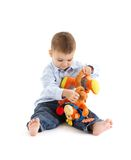 使用与玩具的逗人喜爱的小孩 图库摄影