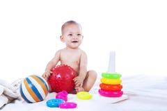 使用与玩具的婴孩 免版税库存照片