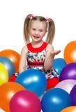 使用与球的一个小女孩的画象 免版税库存照片