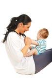 使用与男婴的愉快的母亲 库存图片