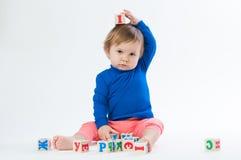 使用与的小孩在白色背景切成小方块隔绝 免版税图库摄影