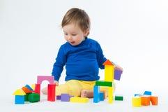使用与的小孩在白色背景切成小方块隔绝 图库摄影