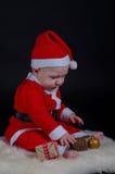 使用与装饰品2的圣诞节婴孩 免版税库存图片