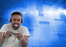 使用与计算机游戏控制器的商人有蓝色行动背景 库存图片