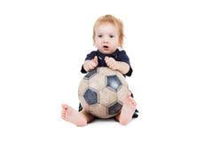 使用与足球的男婴 查出在白色 免版税图库摄影