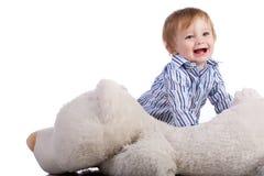 使用与软的玩具的婴孩查出在白色 免版税库存照片