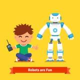 使用与遥控机器人的小男孩 免版税图库摄影