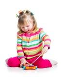 使用与音乐玩具的可爱的子项 图库摄影