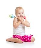 使用与音乐玩具的孩子 免版税图库摄影