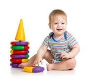 使用与颜色玩具的微笑的子项 库存图片