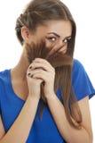 使用与头发的快乐的女孩 免版税库存照片