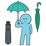 使用伞的人传染媒介  免版税库存照片