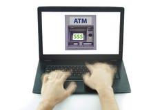 使用便携式计算机和ATM的手与被隔绝的美元的符号 免版税库存图片