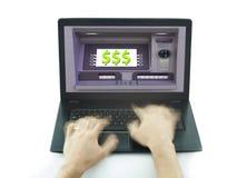 使用便携式计算机和ATM的手与被隔绝的美元的符号 免版税图库摄影