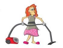 使用吸尘器的妇女 免版税库存照片