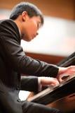 使用在一个古典音乐音乐会的钢琴演奏家在上海骗局 免版税图库摄影