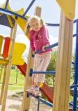 使用在儿童的楼梯的女孩 免版税库存图片