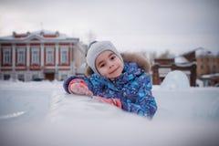 使用在冬天冰镇的婴孩 图库摄影