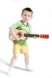 使用在吉他的孩子 免版税库存照片