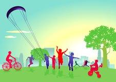 使用在城市公园的孩子 免版税图库摄影