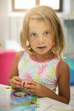 使用在操场的小女孩 免版税库存图片