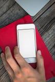 使用在桌上的人手机 免版税库存照片