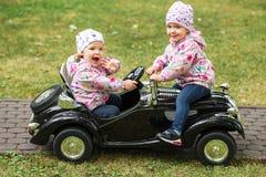 使用在汽车的小女婴 库存图片