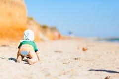 使用在沙滩的婴孩 图库摄影