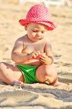 使用在海滩的婴孩 库存照片