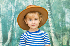 使用在牛仔的小女孩 库存照片