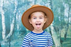 使用在牛仔的小女孩 免版税库存照片
