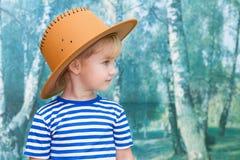 使用在牛仔的小女孩 免版税库存图片