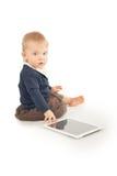 使用在白色的婴孩数字式片剂 免版税库存图片