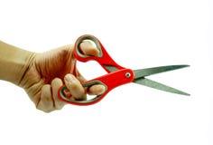 使用在白色背景的人红色剪刀 免版税库存图片