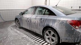 使用在的汽车洗车与水喷气机的泡沫  影视素材