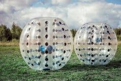 使用在绿色草坪的足球的防撞器球 免版税库存图片
