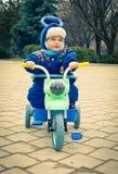 使用在自行车的孩子 图库摄影