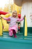使用在颜色有弹性的城堡的小女孩 免版税库存照片