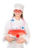 使用在医生的可爱的微笑的小女孩 库存照片