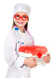 使用在医生的可爱的微笑的小女孩 库存图片